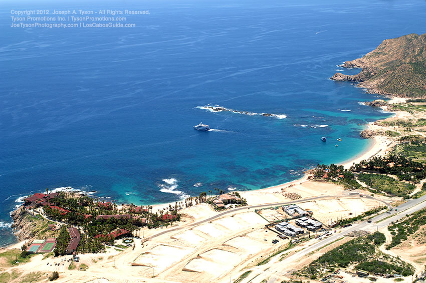 Update September 2012: Construction is once again underway on this project. Aerial view of Chileno Beach and Bay, Cabo San Lucas Tourist Corridor.