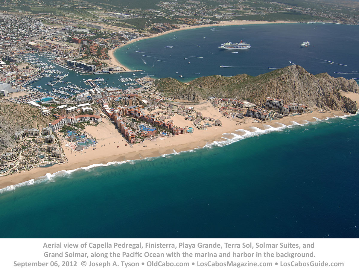 Aerial view of Capella Pedregal, Finisterra, Playa Grande, Terra Sol, Solmar Suites, and Grand Solmar, along the Pacific Ocean with the marina and harbor in the background. September 06, 2012 © Joseph A. Tyson