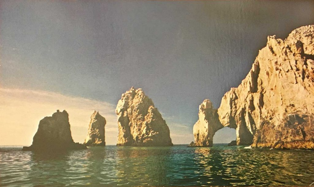 Post card image by Francisco Aramburo of the stone arch at Cabo San Lucas. Photo circa 1970.
